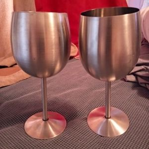 Two stainless steel red wine glass